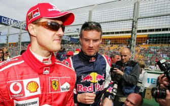 (L to R): Michael Schumacher (GER) Ferrari with David Coulthard (GBR) Red Bull Racing.