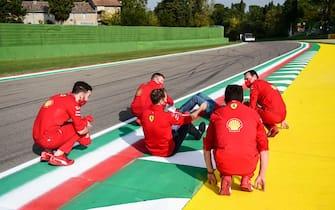 Ferrari's German driver Sebastian Vettel (C) and his team members inspect the Autodromo Internazionale Enzo e Dino Ferrari race track in Imola, Italy, on October 30, 2020, two days ahead of the Formula One Emilia Romagna Grand Prix. (Photo by Miguel MEDINA / AFP) (Photo by MIGUEL MEDINA/AFP via Getty Images)