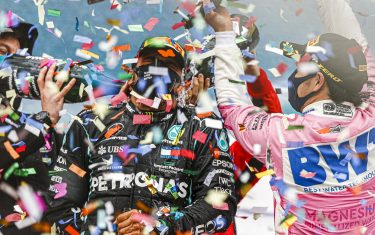 ISTANBUL PARK, TURKEY - NOVEMBER 15: Sebastian Vettel, Ferrari, 3rd position, and Sergio Perez, Racing Point, 2nd position, pour Champagne down the back of Lewis Hamilton, Mercedes-AMG Petronas F1, 1st position, on the podium during the Turkish GP at Istanbul Park on Sunday November 15, 2020, Turkey. (Photo by Andy Hone / LAT Images)