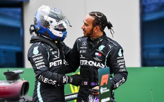 ISTANBUL PARK, TURKEY - NOVEMBER 15: Lewis Hamilton, Mercedes-AMG Petronas F1, 1st position, is congratulated by Valtteri Bottas, Mercedes-AMG Petronas F1, in Parc Ferme after securing his seventhe world drivers title during the Turkish GP at Istanbul Park on Sunday November 15, 2020, Turkey. (Photo by Mark Sutton / Sutton Images)