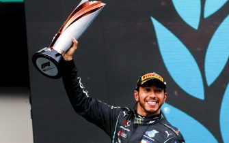 ISTANBUL PARK, TURKEY - NOVEMBER 15: Seven times world drivers champion Lewis Hamilton, Mercedes-AMG Petronas F1, 1st position, lifts his trophy on the podium during the Turkish GP at Istanbul Park on Sunday November 15, 2020, Turkey. (Photo by Steven Tee / LAT Images)