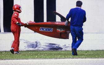 IMOLA, ITALY - APRIL 23: Marshals carry away the rear bodywork of Gerhard Berger's Ferrari 640 after a crash during the San Marino GP at Imola on April 23, 1989 in Imola, Italy. (Photo by Ercole Colombo / Studio Colombo)