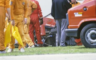 IMOLA, ITALY - APRIL 23: Marshals attend Gerhard Berger's Ferrari 640 after an accident during the San Marino GP at Imola on April 23, 1989 in Imola, Italy. (Photo by Ercole Colombo / Studio Colombo)