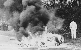 Fire blazes from the burning magnesium of the Honda Racing (France) Honda RA302 Honda V8 of Jo Schlesser of France who was killed on the second lap of the French Grand Prix on 7th July 1968 at the Rouen-Les-Essarts Circuit in Rouen, France. (Photo by AFP/Central Press/Hulton Archive/Getty Images)