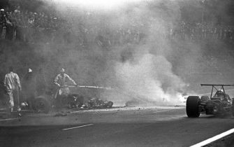 Jo Schlesser, Honda RA302, Grand Prix of France, Rouen-Les-Essarts, 07 July 1968. The awful accident of Jo Schlesser during the 1968 French Grand Prix in Rouen which saw the French driver lose his life.. (Photo by Paul-Henri Cahier/Getty Images)
