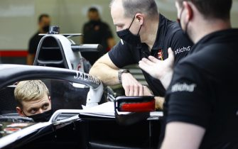 BAHRAIN INTERNATIONAL CIRCUIT, BAHRAIN - DECEMBER 02: Mick Schumacher sits in his Haas VF-20 for his seat fitting with race engineer Gary Gannon during the Sakhir GP at Bahrain International Circuit on Wednesday December 02, 2020 in Sakhir, Bahrain. (Photo by Andy Hone / LAT Images)