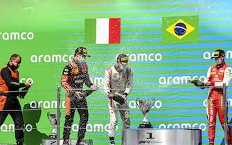 CIRCUIT DE BARCELONA-CATALUNYA, SPAIN - AUGUST 16: Race Winner Felipe Drugovich (BRA, MP MOTORSPORT), Luca Ghiotto (ITA, HITECH GRAND PRIX) and Mick Schumacher (DEU, PREMA RACING) celebrate on the podium with the champagne at Circuit de Barcelona-Catalunya on Sunday August 16, 2020 in Barcelona, Spain. (Photo by Mark Sutton / Sutton Images)