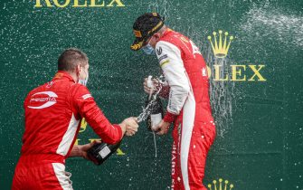 SPA-FRANCORCHAMPS, BELGIUM - AUGUST 30: Mick Schumacher (DEU, PREMA RACING) celebrates on the podium with the champagne at Spa-Francorchamps on Sunday August 30, 2020 in Spa, Belgium. (Photo by Zak Mauger / LAT Images)