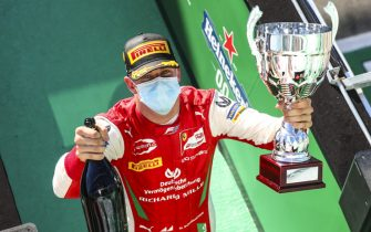 AUTODROMO NAZIONALE MONZA, ITALY - SEPTEMBER 05: Race Winner Mick Schumacher (DEU, PREMA RACING) celebrates on the podium with the champagne and the trophy at Autodromo Nazionale Monza on Saturday September 05, 2020 in Monza, Italy. (Photo by Charles Coates / LAT Images)