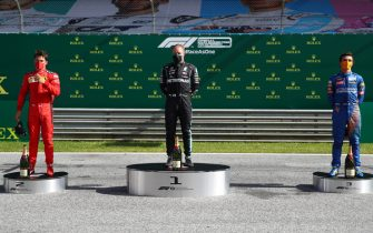 SPIELBERG, AUSTRIA - JULY 05: Race winner Valtteri Bottas of Finland and Mercedes GP, second placed Charles Leclerc of Monaco and Ferrari and third placed Lando Norris of Great Britain and McLaren F1 celebrate on the podium during the Formula One Grand Prix of Austria at Red Bull Ring on July 05, 2020 in Spielberg, Austria. (Photo by Mark Thompson/Getty Images)