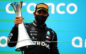 BUDAPEST, HUNGARY - JULY 19: Race winner Lewis Hamilton of Great Britain and Mercedes GP celebrates on the podium after the Formula One Grand Prix of Hungary at Hungaroring on July 19, 2020 in Budapest, Hungary. (Photo by Bryn Lennon/Getty Images)