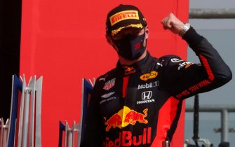 TOPSHOT - Red Bull's Dutch driver Max Verstappen celebrates on the podium after winning the F1 70th Anniversary Grand Prix at Silverstone on August 9, 2020 in Northampton. - The race commemorates the 70th anniversary of the inaugural world championship race, held at Silverstone in 1950. (Photo by Frank Augstein / POOL / AFP) (Photo by FRANK AUGSTEIN/POOL/AFP via Getty Images)