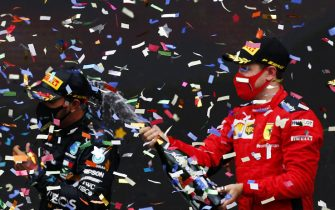 ISTANBUL, TURKEY - NOVEMBER 15: Race winner Lewis Hamilton of Great Britain and Mercedes GP celebrates winning a 7th F1 World Drivers Championship with second placed Sergio Perez of Mexico and Racing Point Third placed Sebastian Vettel of Germany and Ferrari and on the podium during the F1 Grand Prix of Turkey at Intercity Istanbul Park on November 15, 2020 in Istanbul, Turkey. (Photo by Kenan Asyali - Pool/Getty Images)
