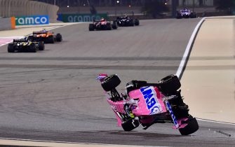 BAHRAIN, BAHRAIN - NOVEMBER 29: Lance Stroll of Canada driving the (18) Racing Point RP20 Mercedes is launched upside down following a crash during the F1 Grand Prix of Bahrain at Bahrain International Circuit on November 29, 2020 in Bahrain, Bahrain. (Photo by Giuseppe Cacace - Pool/Getty Images)
