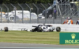 NORTHAMPTON, ENGLAND - AUGUST 02: Daniil Kvyat of Russia and Scuderia AlphaTauri looks at his car after crashing into a track barrier during the F1 Grand Prix of Great Britain at Silverstone on August 02, 2020 in Northampton, England. (Photo by Andrew Boyers/Pool via Getty Images)