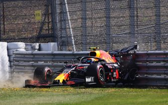 NORTHAMPTON, ENGLAND - JULY 31: Alexander Albon of Thailand driving the (23) Aston Martin Red Bull Racing RB16 crashes into a track barrier during practice for the F1 Grand Prix of Great Britain at Silverstone on July 31, 2020 in Northampton, England. (Photo by Bryn Lennon/Getty Images)