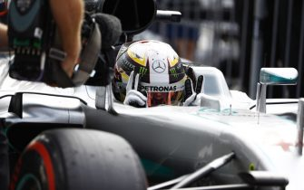 Autodromo Nazionale di Monza, Italy.Saturday 03 September 2016.Lewis Hamilton, Mercedes AMG, celebrates pole position in cocpkit as he enters parc ferme. An FOM camerman films the Briton.World Copyright: Steven Tee/LAT Photographicref: Digital Image _R3I6607