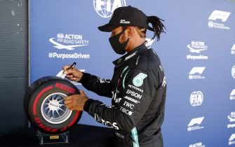 SILVERSTONE, UNITED KINGDOM - AUGUST 01: Pole Sitter Lewis Hamilton, Mercedes-AMG Petronas F1 signs the Pirelli Pole Position Award during the British GP at Silverstone on Saturday August 01, 2020 in Northamptonshire, United Kingdom. (Photo by Steven Tee / LAT Images)