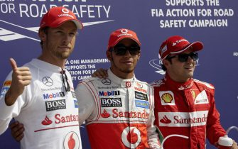 AUTODROMO NAZIONALE MONZA, ITALY - SEPTEMBER 09: Top 3 fastest in qualifying: Jenson Button, 2nd position, pole sitter Lewis Hamilton, and Felipe Massa, 3rd position during the Italian GP at Autodromo Nazionale Monza on September 09, 2012 in Autodromo Nazionale Monza, Italy. (Photo by Rainer Schlegelmilch)
