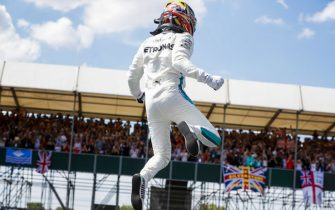 SILVERSTONE, UNITED KINGDOM - JULY 07: Lewis Hamilton, Mercedes AMG F1, jumps from his car as he celebrates after taking Pole Position during the British GP at Silverstone on July 07, 2018 in Silverstone, United Kingdom. (Photo by Steven Tee / LAT Images)