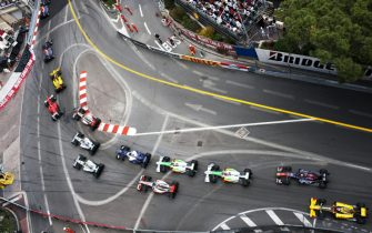 Australian Red Bull Racing Formula One driver Mark Webber driving his RB6 racing car leads the field of cars and drivers through Sainte Devote corner watched by spectators, fans and crowd and circuit safety workers on lap one of the 2010 Monaco Grand Prix, Monte Carlo, on the 16 May 2010. (Photo by Darren Heath/Getty Images)
