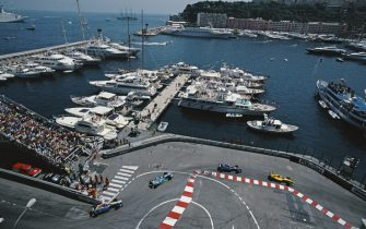 A generic view of the Nouvelle Chicane as the cars pass and the super yachts moored in the harbour during the Formula One Monaco Grand Prix on 16 May 1999 at the Circuit de Monaco, Monte-Carlo, Monaco.  (Photo by Darren Heath/Getty Images)