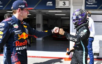 HUNGARORING, HUNGARY - JULY 31: Pole man Sir Lewis Hamilton, Mercedes, fist bumbs Max Verstappen, Red Bull Racing, in Parc Ferme after Qualifying during the Hungarian GP at Hungaroring on Saturday July 31, 2021 in Budapest, Hungary. (Photo by Mark Sutton / Sutton Images)