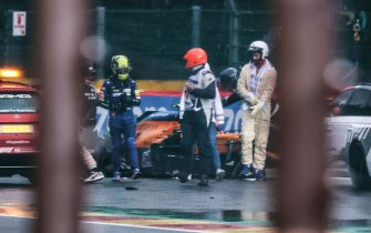 McLaren's British driver Lando Norris (L) walks away from his car after crashing in the qualifying session of the Formula One Belgian Grand Prix at the Spa-Francorchamps circuit in Spa on August 28, 2021. (Photo by KENZO TRIBOUILLARD / AFP) (Photo by KENZO TRIBOUILLARD/AFP via Getty Images)
