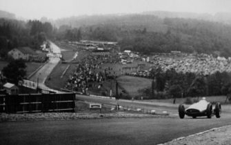 British racing driver Dick Seaman (1913 - 1939) driving his #26 Mercedes-Benz W154 race car on lap 21 at the Belgian Grand Prix, Circuit de Spa-Francorchamps, Belgium, 25th June 1939. This would be the last lap of his career as he would die from injuries in a fatal accident on the next lap. (Photo by Hulton Archive/Getty Images)