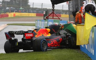 CIRCUIT DE SPA FRANCORCHAMPS, BELGIUM - AUGUST 29: Sergio Perez, Red Bull Racing RB16B, climbs out of his car after crashing on the way to the grid during the Belgian GP at Circuit de Spa Francorchamps on Sunday August 29, 2021 in Spa, Belgium. (Photo by Charles Coates / LAT Images)