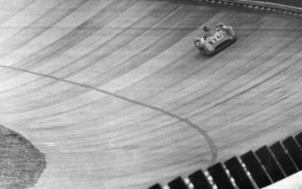 """""""Argentinian racing driver Juan Manuel Fangio on a racing car Mercedes Benz W196 bearing the number 18 doing a banked curve of the autodrome at 26th Italian Grand Prix. He'll win the race. Monza, 11th September 1955  (Photo by Emilio Ronchini\Mondadori via Getty Images)"""""""