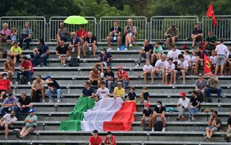 Supporters watch the first practice session at the Autodromo Nazionale circuit in Monza, on September 10, 2021, ahead of the Italian Formula One Grand Prix. (Photo by ANDREJ ISAKOVIC / AFP) (Photo by ANDREJ ISAKOVIC/AFP via Getty Images)