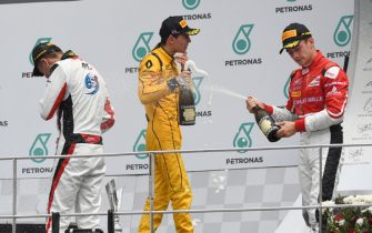 Race winner Alexander Albon (THA) ART Grand Prix, Jack Aitken (GBR) Arden International and Charles Leclerc (MON) ART Grand Prix celebrate on the podium with the champagne at GP3 Series, Rd8, Sepang, Malaysia, 30 September - 2 October 2016.