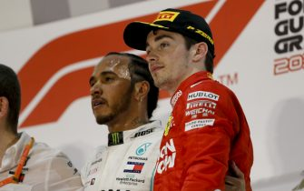 BAHRAIN INTERNATIONAL CIRCUIT, BAHRAIN - MARCH 31: Lewis Hamilton, Mercedes AMG F1, 1st position, and Charles Leclerc, Ferrari, 3rd position, on the podium during the Bahrain GP at Bahrain International Circuit on March 31, 2019 in Bahrain International Circuit, Bahrain. (Photo by Zak Mauger / LAT Images)