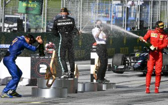 JULY 05: Lando Norris, McLaren, Race winner Valtteri Bottas, Mercedes-AMG Petronas F1 and Charles Leclerc, Ferrari celebrate on the podium with the champagne during the Austrian GP on Sunday July 05, 2020. (Photo by Mark Sutton / Sutton Images)