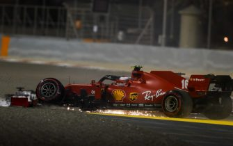 BAHRAIN INTERNATIONAL CIRCUIT, BAHRAIN - DECEMBER 06: Charles Leclerc, Ferrari SF1000 with broken front suspention after a first lap crash with Sergio Perez, Racing Point RP20 during the Sakhir GP at Bahrain International Circuit on Sunday December 06, 2020 in Sakhir, Bahrain. (Photo by Charles Coates / LAT Images)