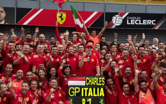AUTODROMO NAZIONALE MONZA, ITALY - SEPTEMBER 08: Race winner Charles Leclerc, Ferrari  poses for a photograph with his Ferrari team during the Italian GP at Autodromo Nazionale Monza on September 08, 2019 in Autodromo Nazionale Monza, Italy. (Photo by Simon Galloway / Sutton Images)