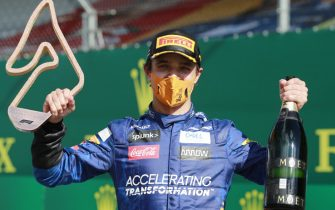 JULY 05: Lando Norris, McLaren, celebrates with his trophy and champagne during the Austrian GP on Sunday July 05, 2020. (Photo by Steven Tee / LAT Images)