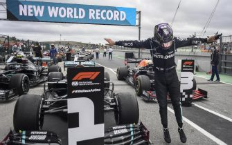 epa08773010 The winner British Formula One driver Lewis Hamilton of Mercedes-AMG Petronas jumps from his car after the Formula One Grand Prix of Portugal at the Autodromo Internacional do Algarve near Portimao, Portugal, 25 October 2020.  EPA/Jorge Guerrero / Pool