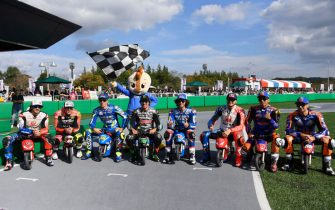 "MOTEGI, JAPAN - OCTOBER 17:  The MotoGP riders pose with the minibikes during the Minimoto race during the pre-event ""Minimoto race  in Mobi Park"" during the MotoGP of Japan - Press Conference at Twin Ring Motegi on October 17, 2019 in Motegi, Japan. (Photo by Mirco Lazzari gp/Getty Images)"