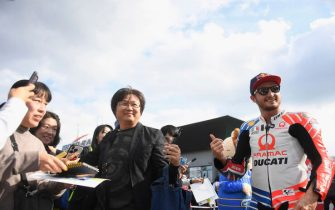 "MOTEGI, JAPAN - OCTOBER 17: Jack Miller of Australia and Pramac Racing  smiles with fans during the pre-event ""Minimoto race  in Mobi Park"" during the MotoGP of Japan - Press Conference at Twin Ring Motegi on October 17, 2019 in Motegi, Japan. (Photo by Mirco Lazzari gp/Getty Images)"