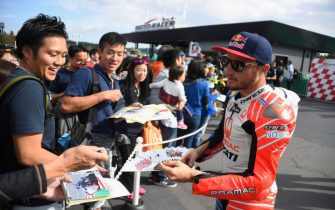 "MOTEGI, JAPAN - OCTOBER 17:  Jack Miller of Australia and Pramac Racing  signs autographs for fans during the pre-event ""Minimoto race  in Mobi Park"" during the MotoGP of Japan - Press Conference at Twin Ring Motegi on October 17, 2019 in Motegi, Japan. (Photo by Mirco Lazzari gp/Getty Images)"