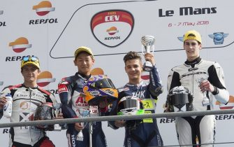 LE MANS, FRANCE - MAY 07:  Lorenzo Dalla Porta of Italy and Laglisse Academy 3rd L) celebrates the victory in the podium at the end of the Fim Cev Repsol Moto3 Junior World Championship during the MotoGp of France - Qualifying at  on May 7, 2016 in Le Mans, France.  (Photo by Mirco Lazzari gp/Getty Images)
