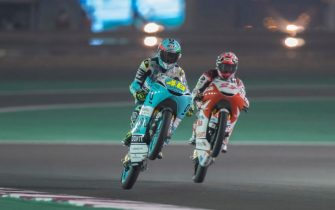 DOHA, QATAR - MARCH 09: (L-R) Lorenzo Dalla Porta of Italy and Leopard Racing,  and Kaito Toba of Japan and Honda Team Asia celebrate at the end of the qualifying practice during the MotoGP of Qatar - Qualifying at Losail Circuit on March 09, 2019 in Doha, Qatar. (Photo by Mirco Lazzari gp/Getty Images)
