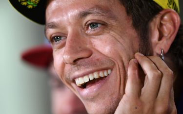 Movistar Yamaha MotoGP's Italian rider Valentino Rossi jokes during a press conference at the Marco Simoncelli Circuit, on September 8, 2016, ahead of the San Marino MotoGP Grand Prix race in Misano. / AFP PHOTO / GABRIEL BOUYS        (Photo credit should read GABRIEL BOUYS/AFP/Getty Images)