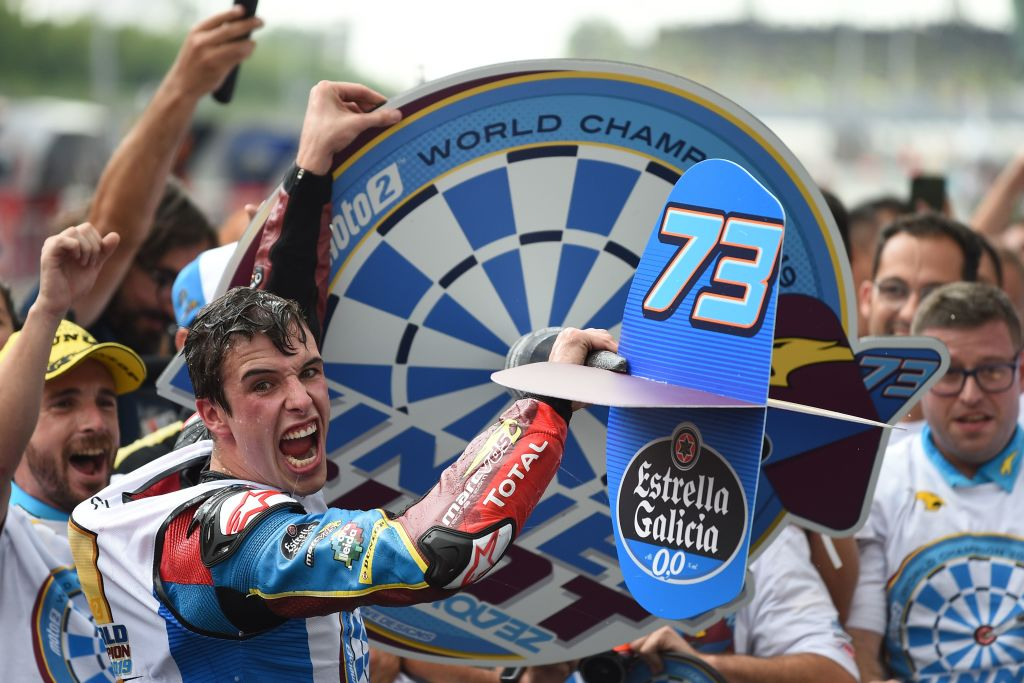 EG 0,0 Marc VDS's Spanish rider Alex Marquez (C) celebrates becoming Moto2 world champion following the Moto2-class Malaysian Grand Prix motorcycle race at the Sepang International Circuit in Sepang on November 3, 2019. (Photo by Mohd RASFAN / AFP) (Photo by MOHD RASFAN/AFP via Getty Images)