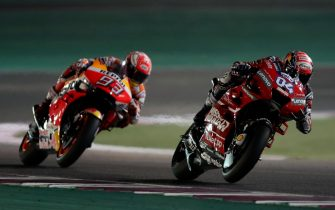 TOPSHOT - Mission Winnow Ducati's Italian rider Andrea Dovizioso (R) and Repsol Honda's Spanish rider Marc Marquez compete during the Qatar MotoGP grand prix at the Losail track in Qatar's capital Doha on March 10, 2019. (Photo by KARIM JAAFAR / AFP)        (Photo credit should read KARIM JAAFAR/AFP via Getty Images)