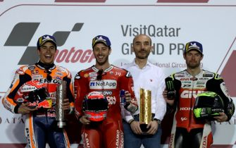 (L to R) Repsol Honda's Spanish rider Marc Marquez, Mission Winnow Ducati's Italian rider Andrea Dovizioso, and LCR Honda Castrol's British rider Cal Crutchlow pose on the podium with their trophies after the Qatar MotoGP grand prix at the Losail track in Qatar's capital Doha on March 10, 2019. - Ducati's Dovizioso won the Qatari GP with Respol Honda's Marquez finishing second and LCR Honda's Crutchlow finished third. (Photo by KARIM JAAFAR / AFP)        (Photo credit should read KARIM JAAFAR/AFP via Getty Images)