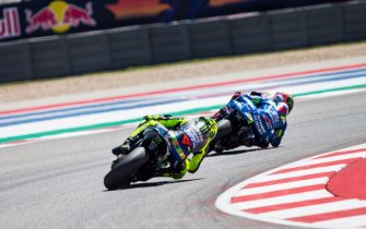 AUSTIN, TX - APRIL 14: Valentino Rossi of Italy and Alex Rins of Spain rounds the bend during the Finals at MotoGP Red Bull U.S. Grand Prix of The Americas at Circuit of The Americas on April 14, 2019 in Austin, Texas. (Photo by Christian Pondella/Getty Images)