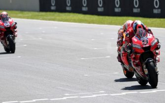 (FromR) Italy's Danilo Petrucci, Spain's Marc Marquez and Italy's Andrea Dovizioso compete on their way to cross the finish line during the Italian Moto GP Grand Prix at the Mugello race track on June 2, 2019 in Scarperia e San Piero. (Photo by Tiziana FABI / AFP)        (Photo credit should read TIZIANA FABI/AFP via Getty Images)